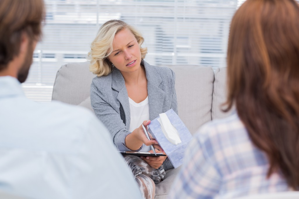 Therapist giving tissue to a woman because she is crying